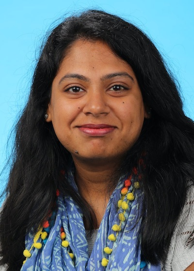A head-and-shoulders professional photo of Vagisha Ravi
