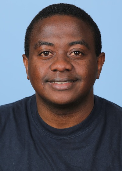 A head-and-shoulders professional photo of Paddy Ssentongo