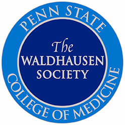 "A circular blue symbol, with ""Penn State College of Medicine"" in a ring around the edge, with ""The Waldhausen Society"" in the middle."