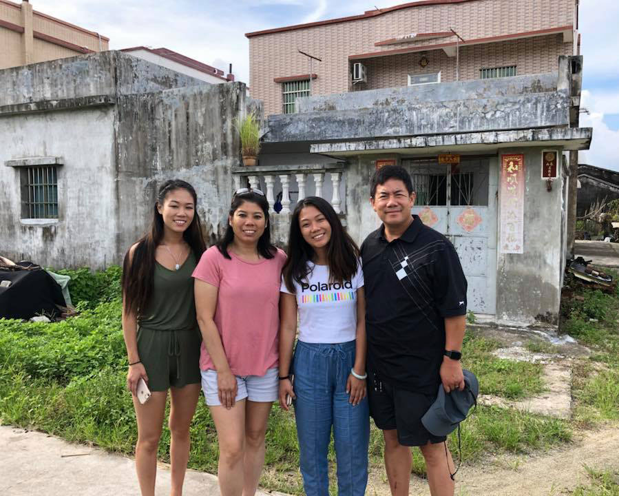 Ashley Wong, a second-year medical student in 2019-2020, is pictured standing with her family outside a house.
